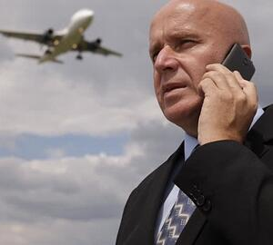 airport on phone businessman.jpg