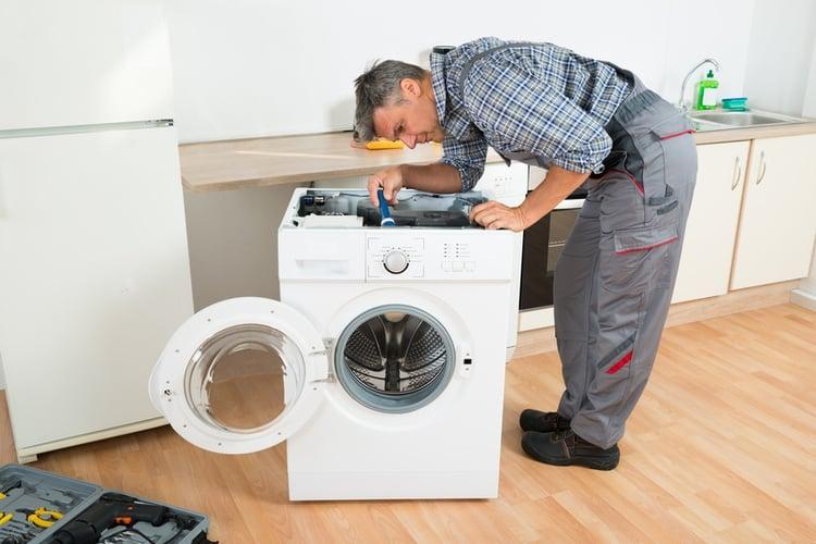 Technician-Repairing-Washing-Machine.jpg